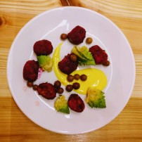 Beetroot gnocchi with pickled grapes, romanesco and saffron yogurt
